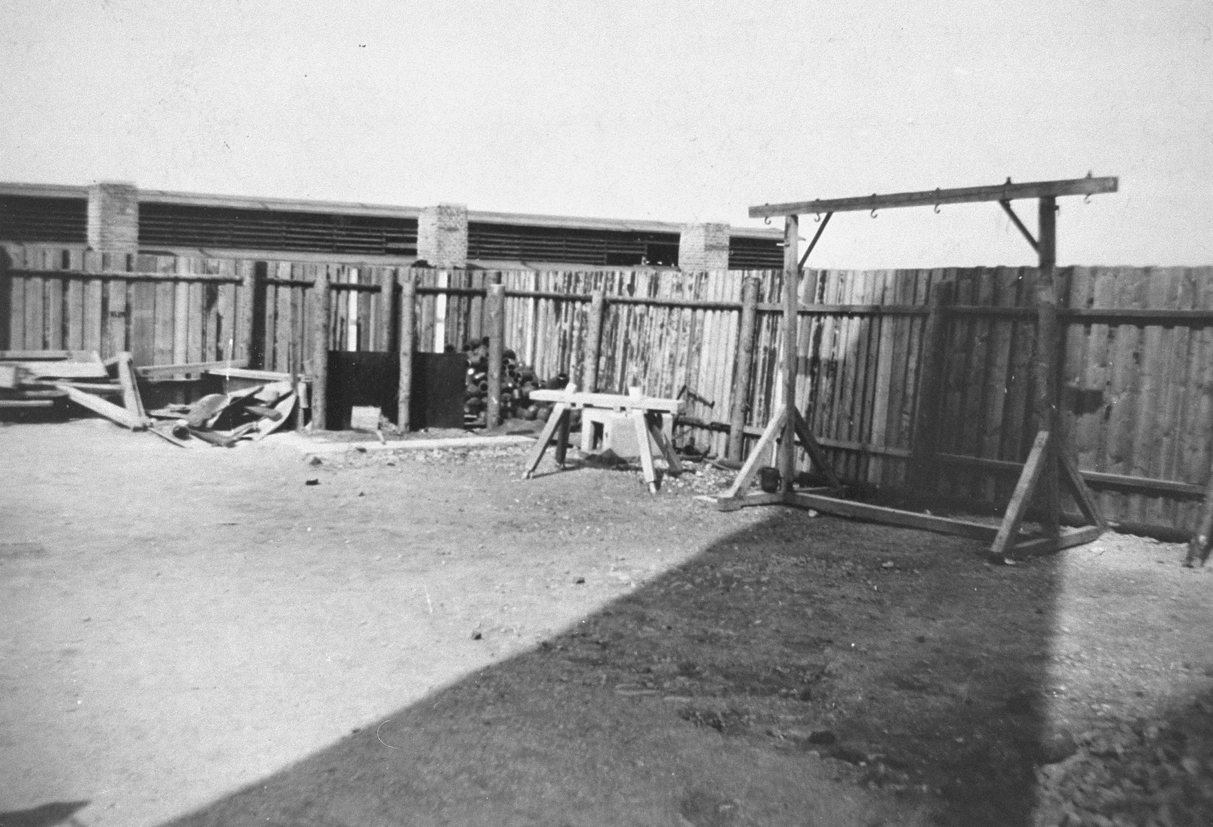 """View of a gallows at Buchenwald.  The inscription on the back of the photograph reads, """"Hanging wrack [sic] for prisoners. If prisoners weren't cremated they were hung on this wrack.  5/7/45.  Just off the picture was a stack of human bones about 25' square and high."""""""