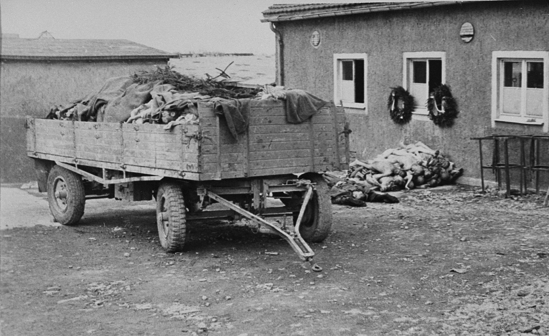 A wagon loaded with corpses intended for burial stands outside the crematorium in Buchenwald..