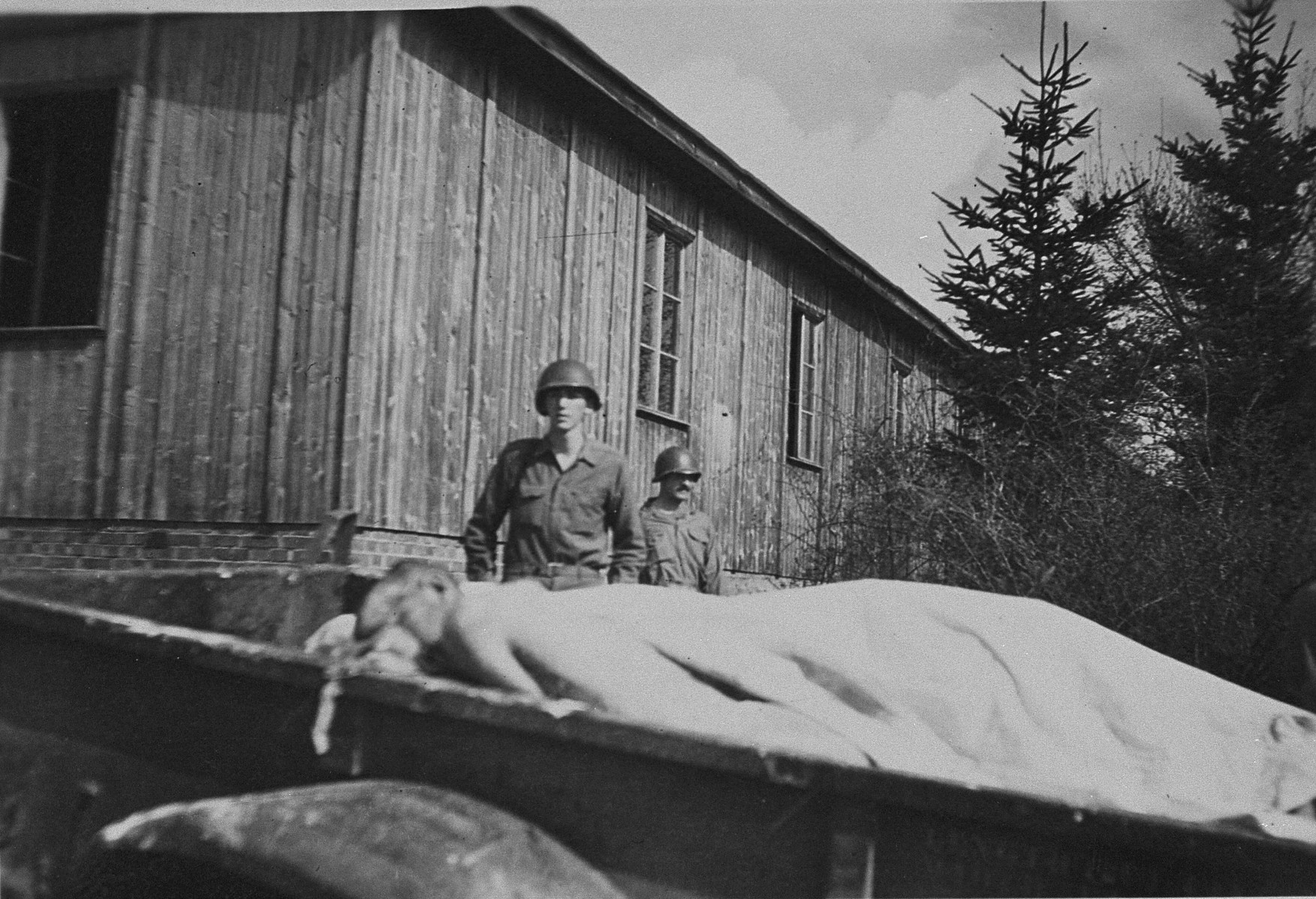 American soldiers view a wagon full of corpses at the newly liberated Ohrdruf concentration camp.