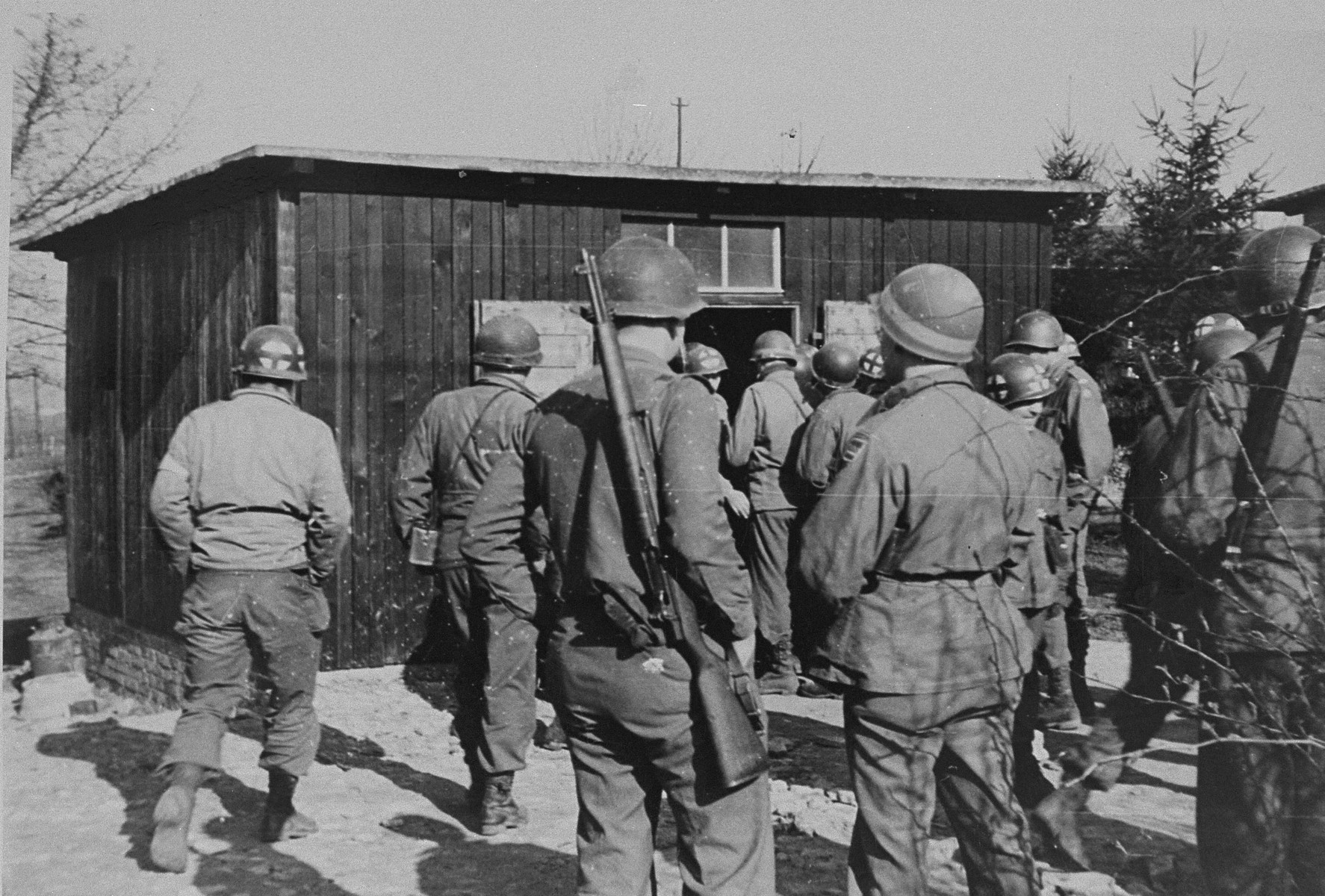 American soldiers on an inspection tour of the newly liberated Ohrdruf concentration camp.