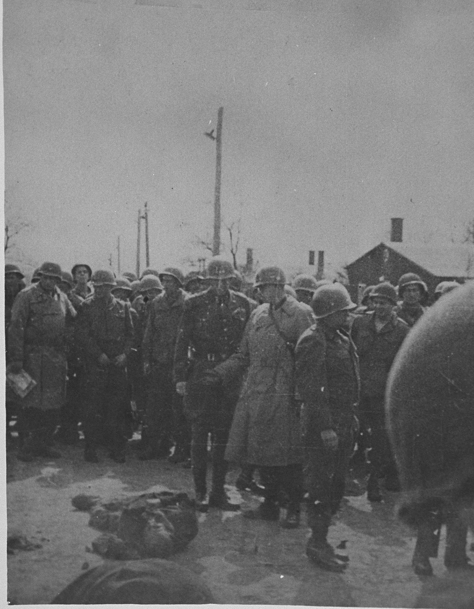 While on an inspection tour of the newly liberated Ohrdruf concentration camp, Generals George Patton and Omar Bradley view the bodies of prisoners shot by SS during the evacuation of the camp.