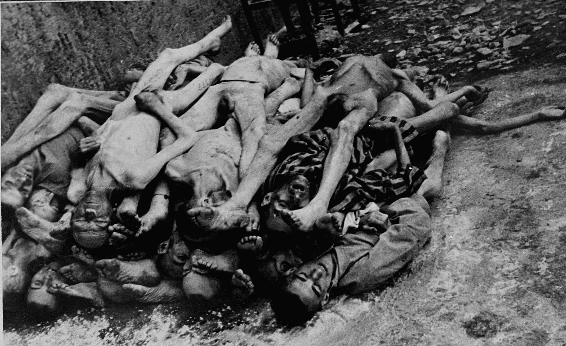 Corpses stacked behind the crematorium in Buchenwald.
