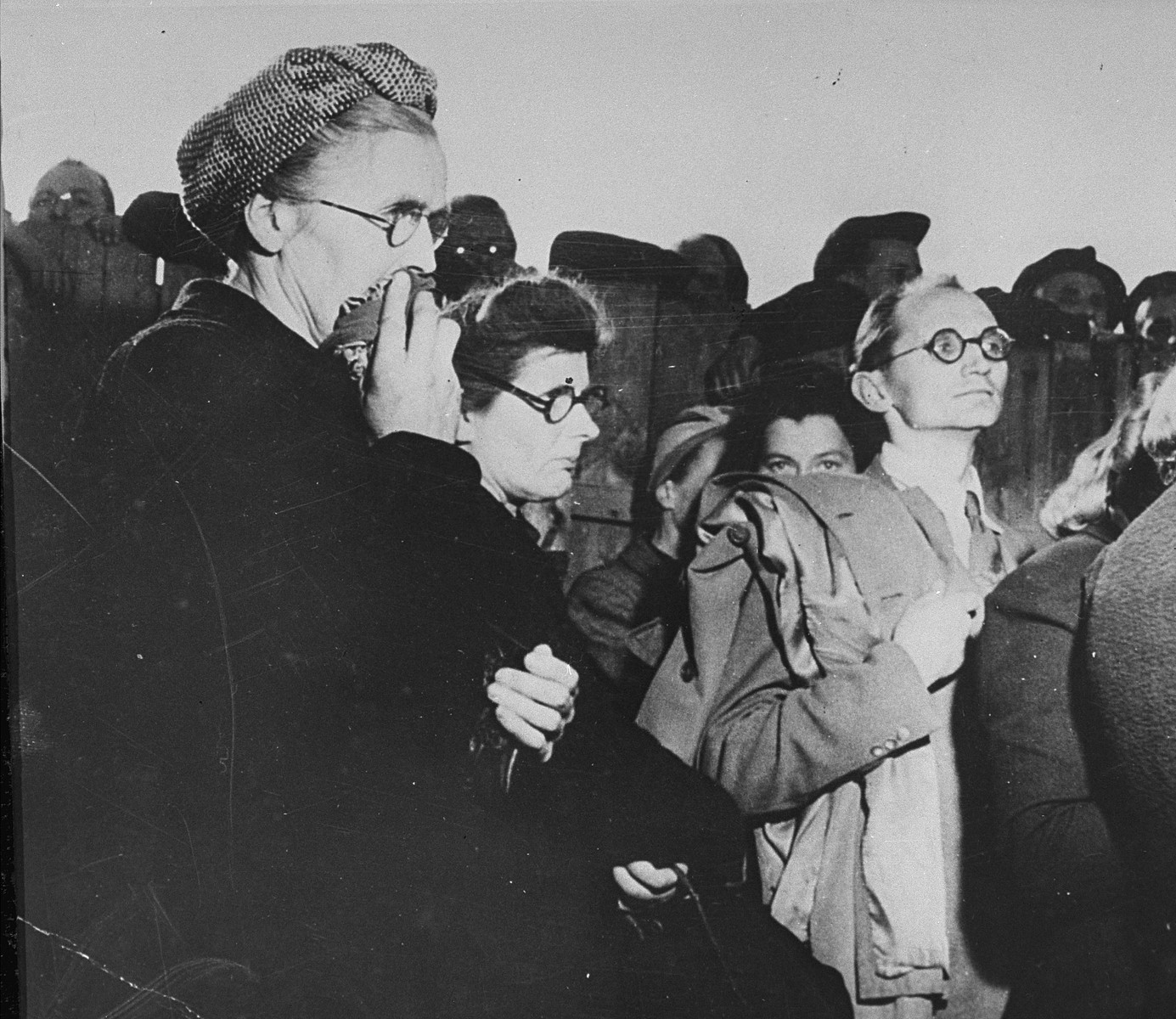 German cititzens who have been forced by the American Army to see the crimes committed in Buchenwald camp.