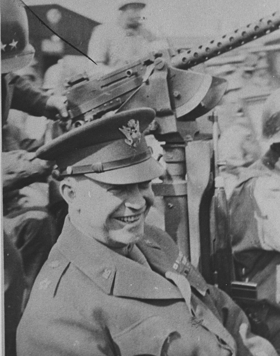 General Dwight Eisenhower sitting in a jeep in Ohrdruf during his inspection tour of the newly liberated concentration camp.