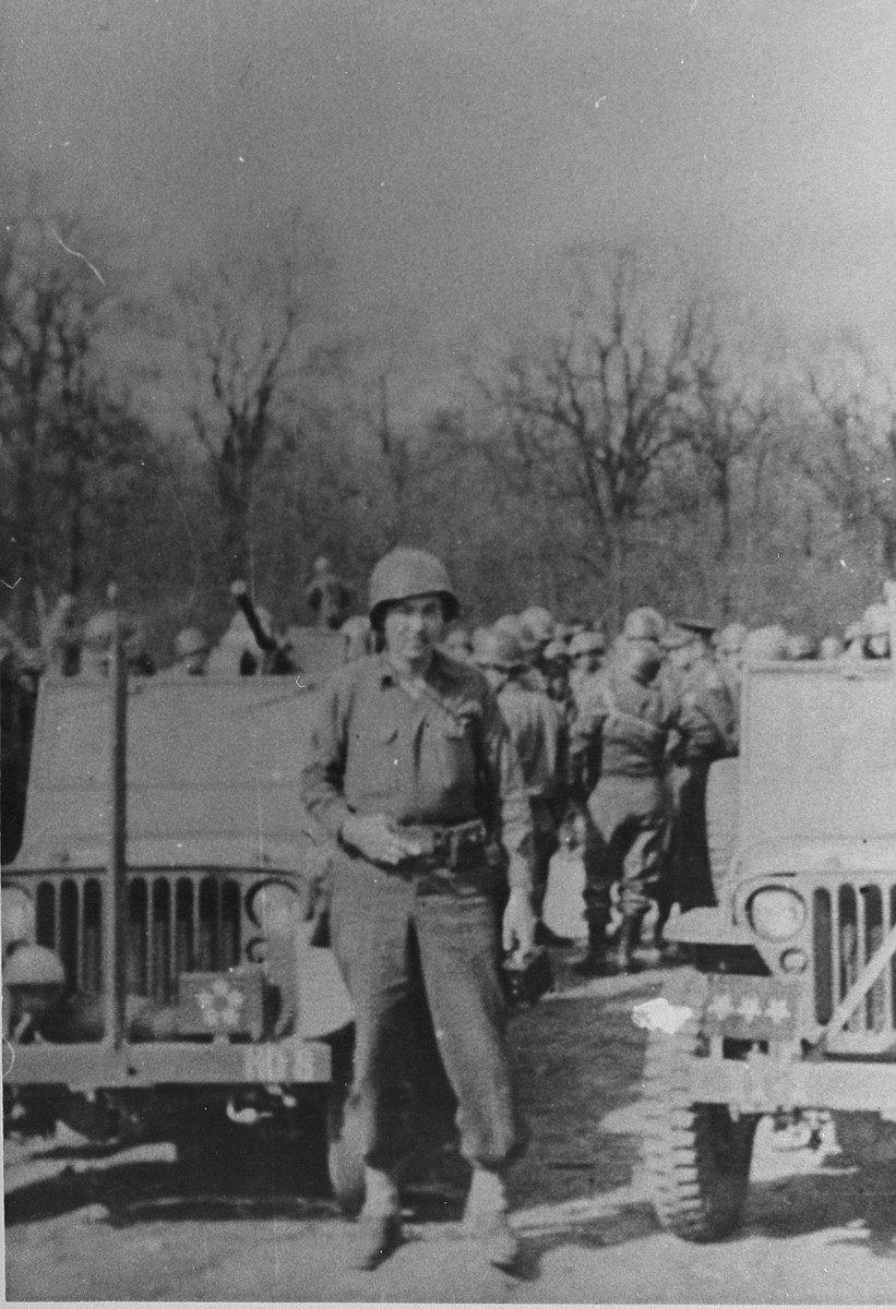 American liberator Fred Mercer poses in front of a jeep in Ohrdruf during General Dwight Eisenhower's inspection tour of the newly liberated concentration camp.