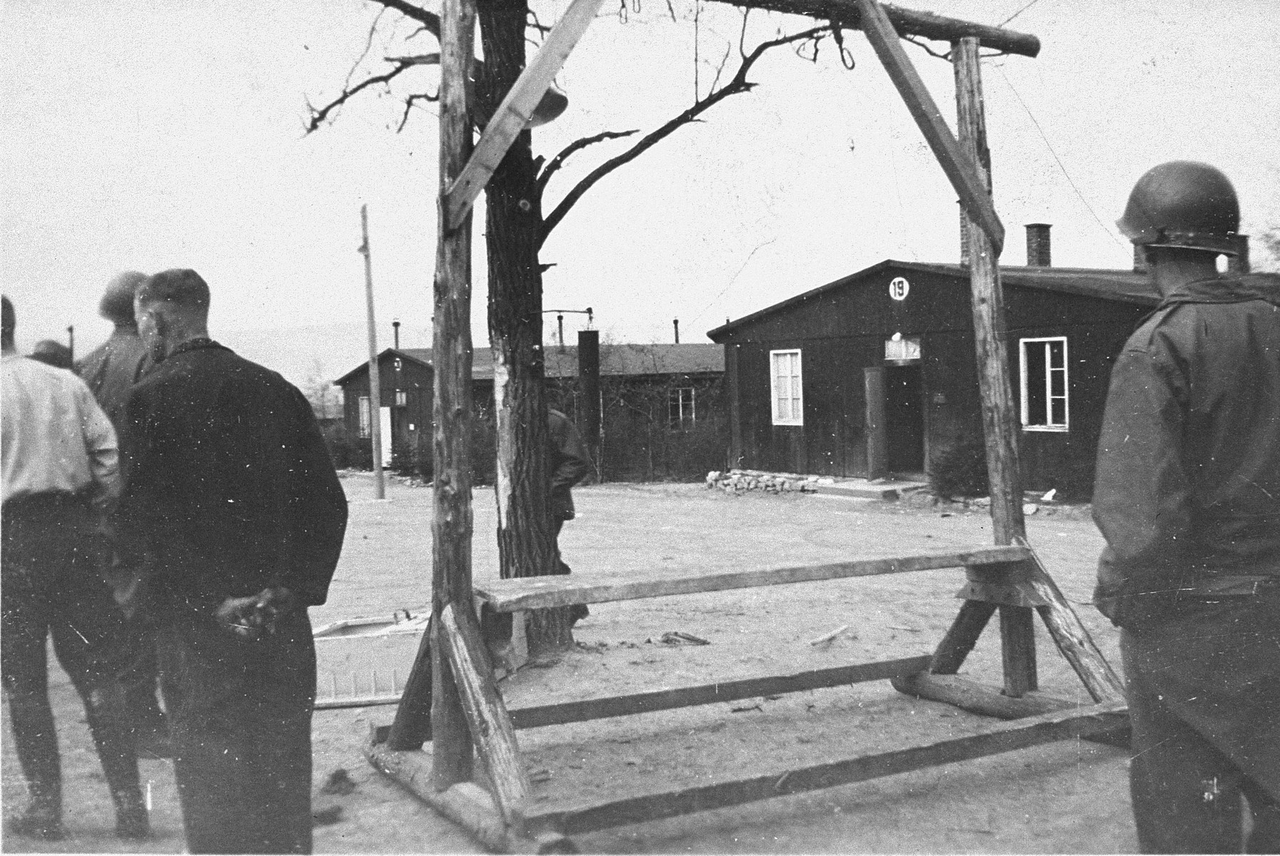 An American soldier views the gallows at the newly liberated Ohrdruf concentration camp during an inspection tour.