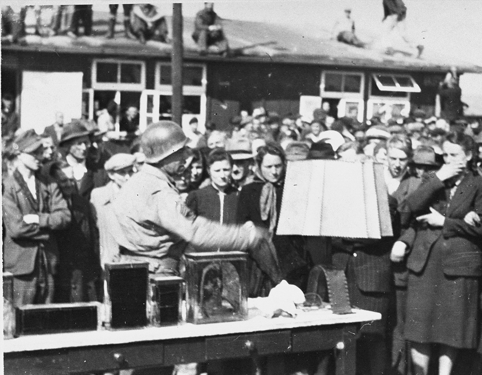 American soldiers force German civilians to view  items made from human skin and body parts, in Buchenwald.