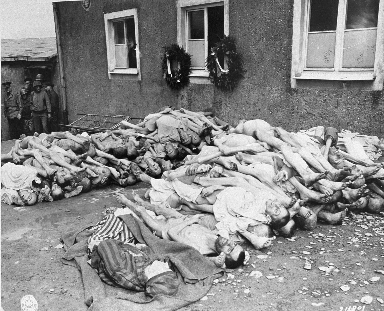 The bodies of former prisoners are stacked outside the crematorium in the newly liberated Buchenwald concentration camp.