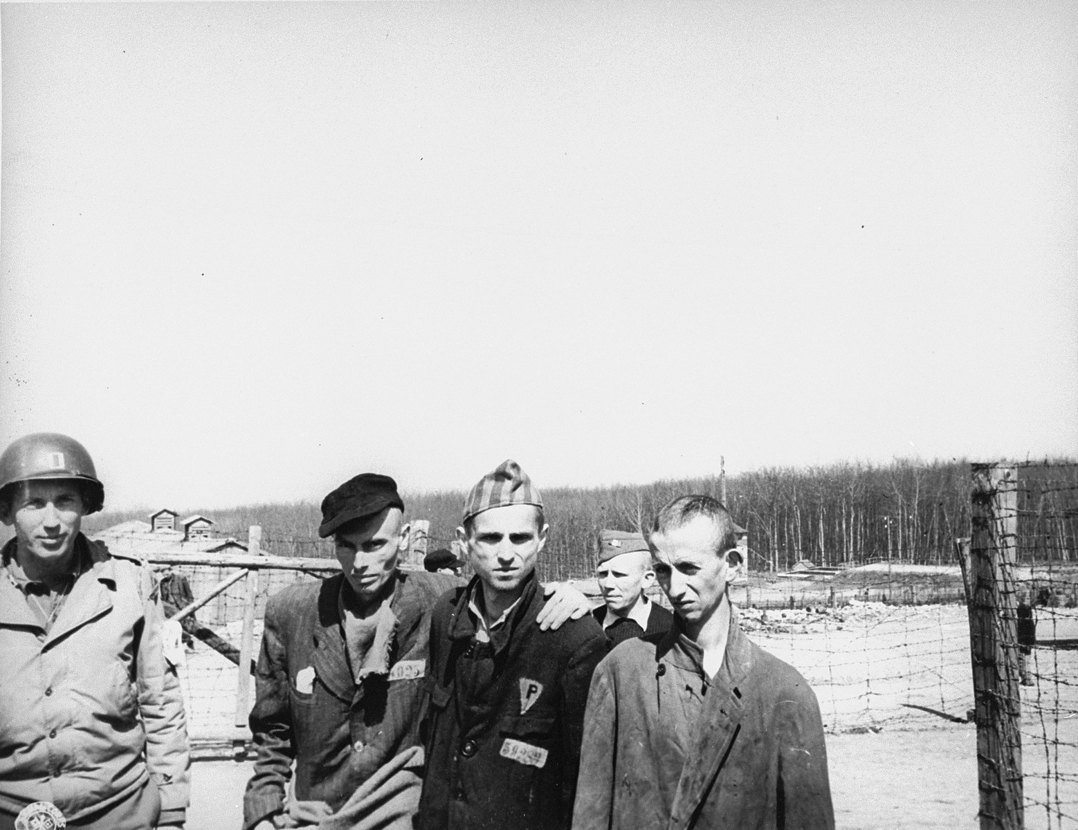 An American captain with survivors in the Buchenwald concentration camp.