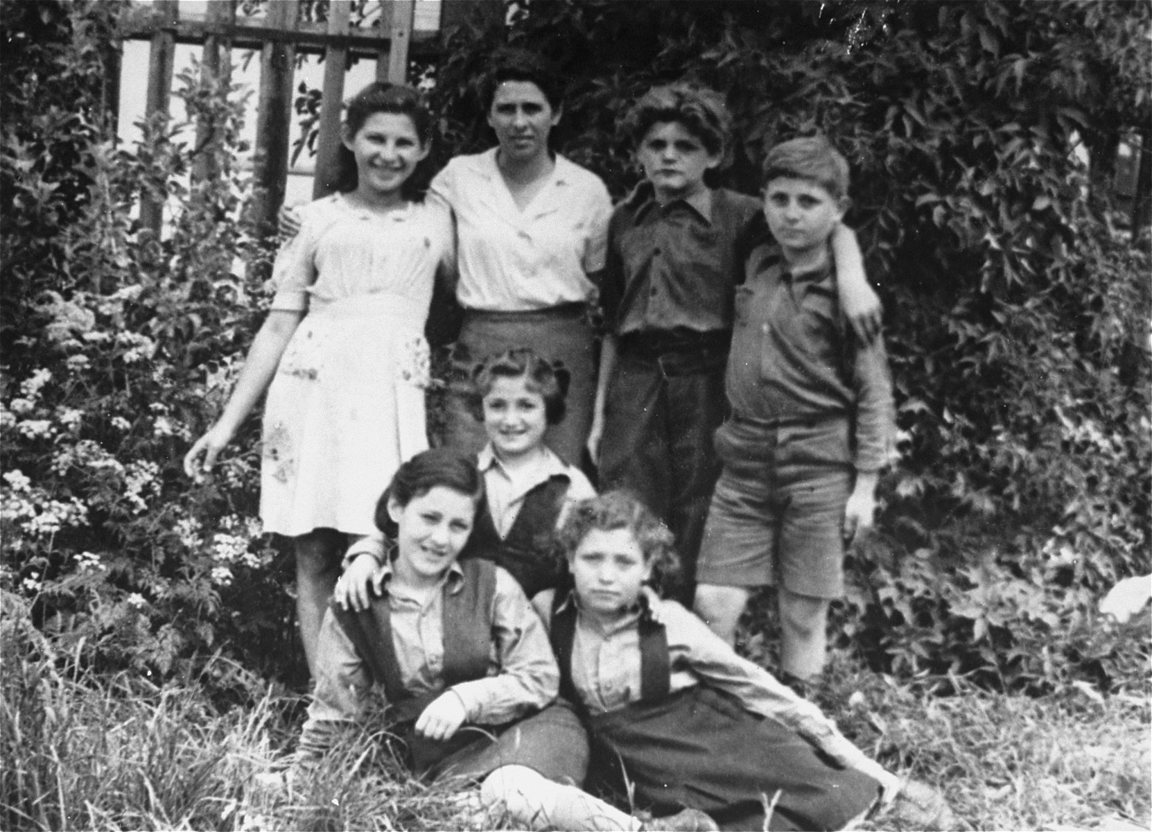 Group portrait of Jewish children in the Landsberg displaced persons' camp.  Pictured sitting first from the left is Cilia Rudashevshky.  Her mother Rose stands second from the left.