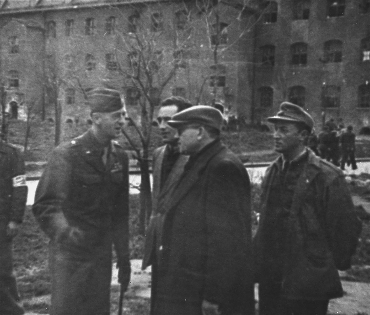 General Onslow S. Rolfe (left) and Dr. Samuel Gringaus (center) speak to Jewish DPs at the Landsberg displaced persons camp.
