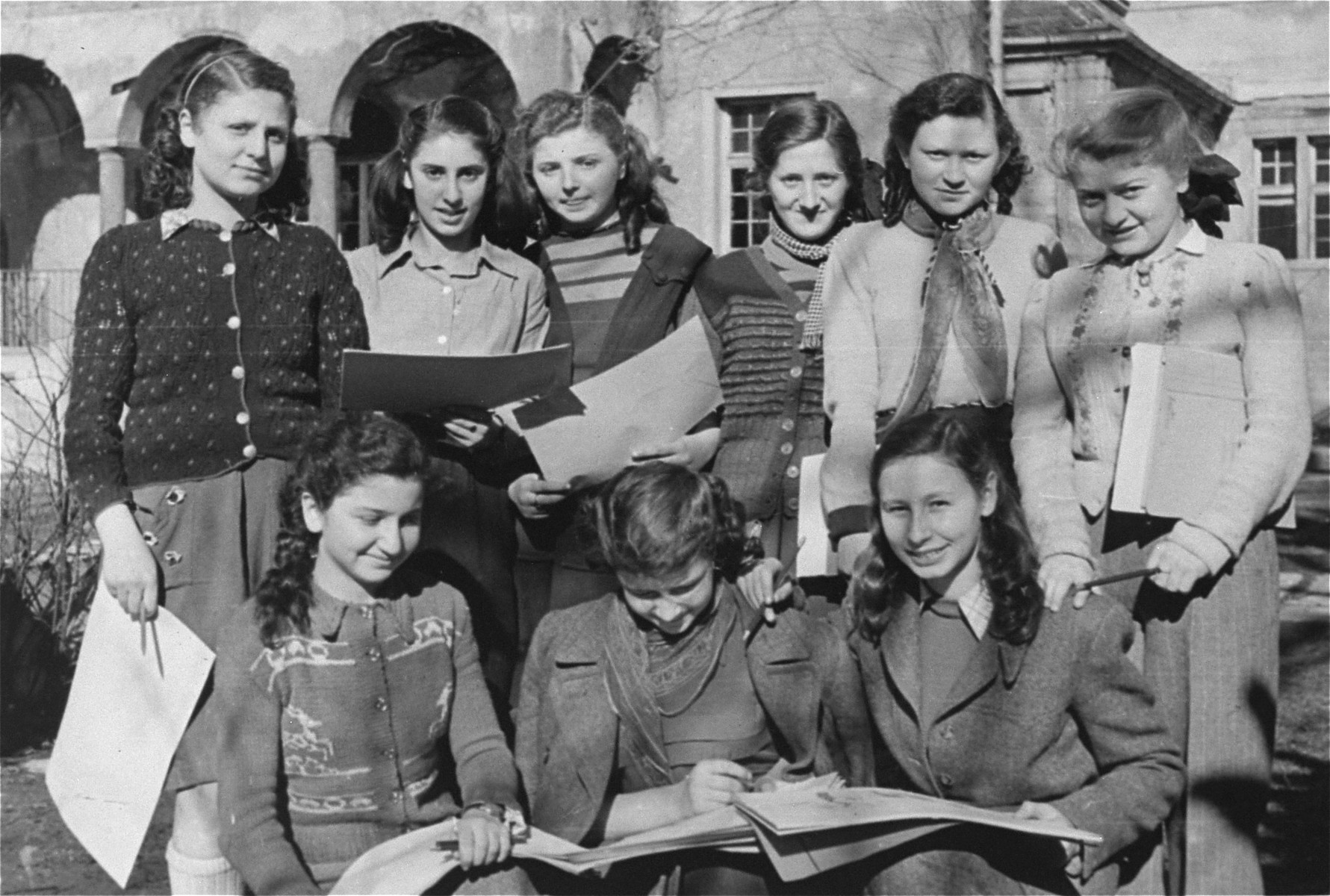Group portrait of Jewish DP girls attending the Moehlstrasse school in Munich.  Pictured standing from left to right, are: Judy Hechtkopf, Bronia Zwass, Rozia (Shoshana) Grossman, unknown, Rivka Dzijloszycka.  Seated in the middle is Gunia Herring.