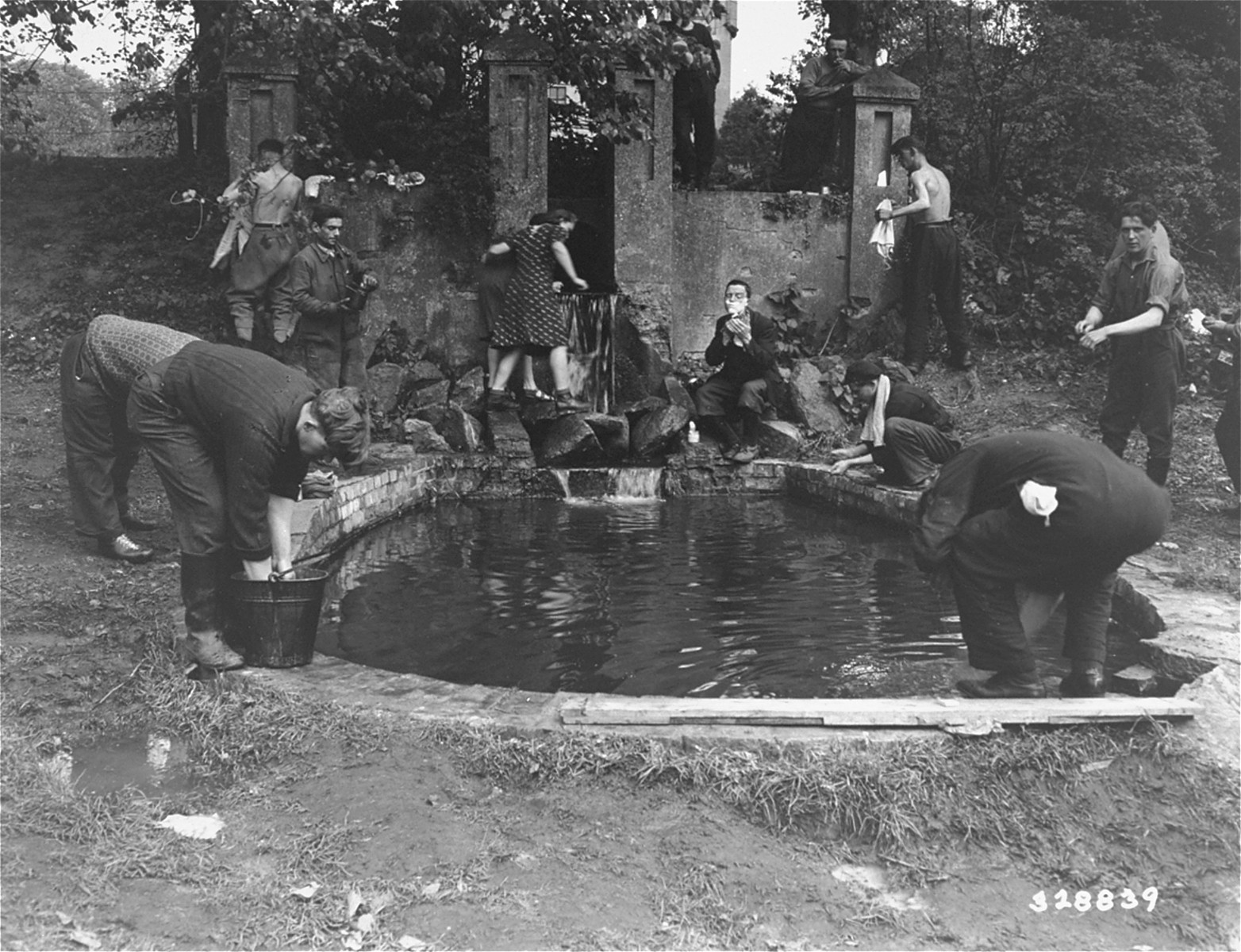 Jewish DPs wash up in a pool at a displaced persons camp near Hagenow, Germany.