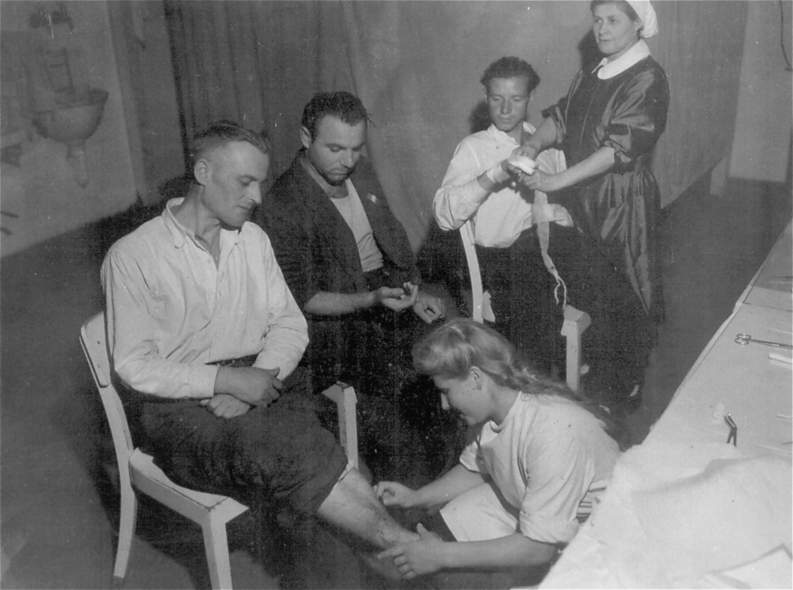Displaced persons awaiting repatriation are cared for by Russian nurses at the infirmary of a DP camp in Goeppingen.