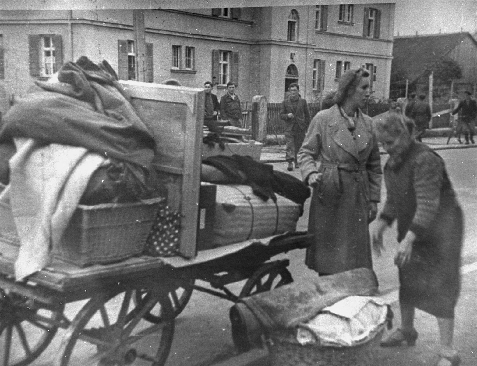 German women are forced to evacuate their homes to make room for Jewish displaced persons.