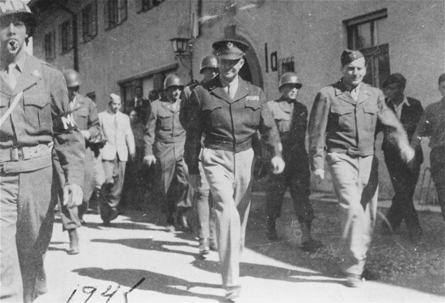Generals Eisenhower and Patton tour the DP camp at Feldafing.  Eisenhower's visits to Feldafing and other displaced persons' camps in the fall of 1945 was prompted by a strongly worded cable he received  from President Truman directing him to institute reforms to improve the living conditions of displaced Jews in the American zone of occupation. At Feldafing Eisenhower toured the grounds and attended religious services at the camp synagogue, where he delivered a brief address to the assembled survivors. In his speech Eisenhower pledged the assistance of the American army and counselled patience until the Jewish DPs could leave Germany. The Zionist leadership of the camp presented him with two memoranda. One described the situation of the Jews in Feldafing; the other urged free immigration to Palestine and the establishment of a Jewish State. Accompanying Eisenhower on his inspection tour was General George Patton. While Eisenhower was genuinely dismayed by the poor living conditions he saw in the camp, Patton showed no sympathy toward the survivors.