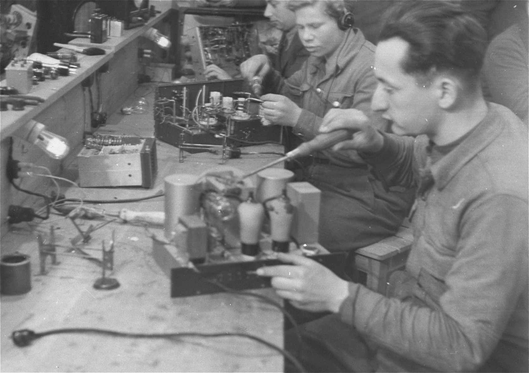 A group of men builds radios in an ORT (Organization for Rehabilitation through Training) training workshop in the Landsberg displaced persons' camp.