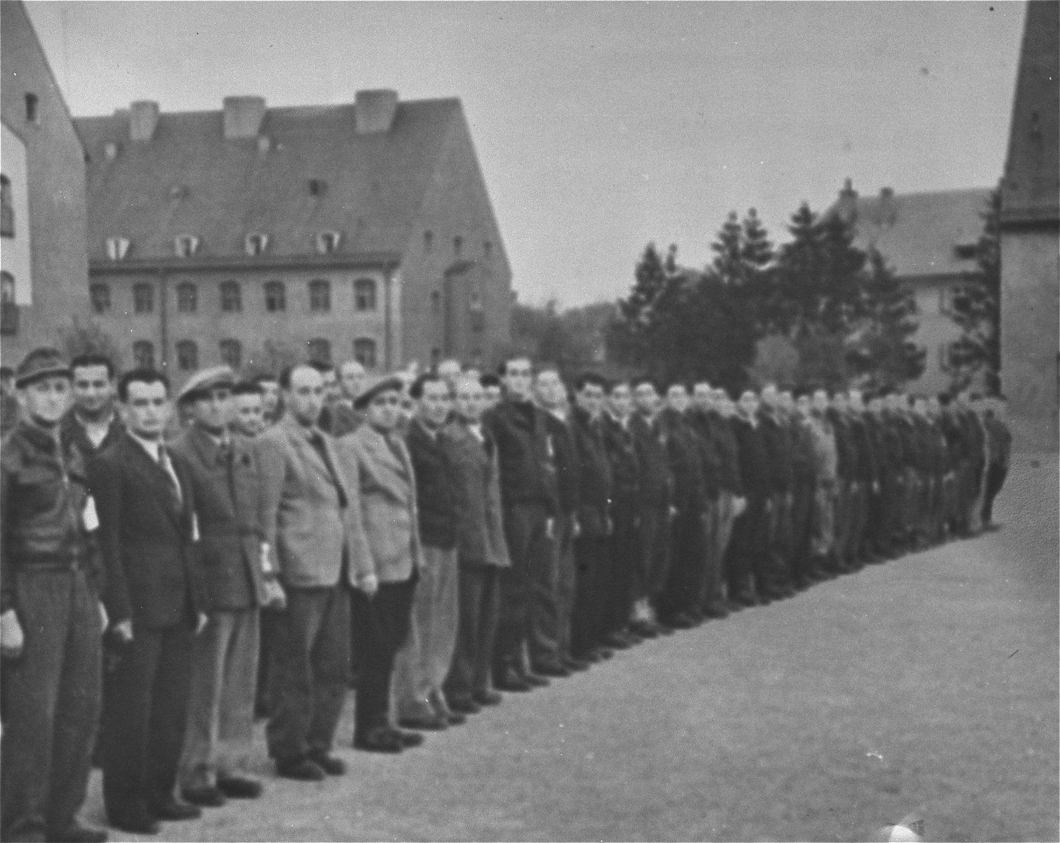 Members of the Jewish police force at the Landsberg displaced persons' camp line up in the main square of the camp. [Oversized print]