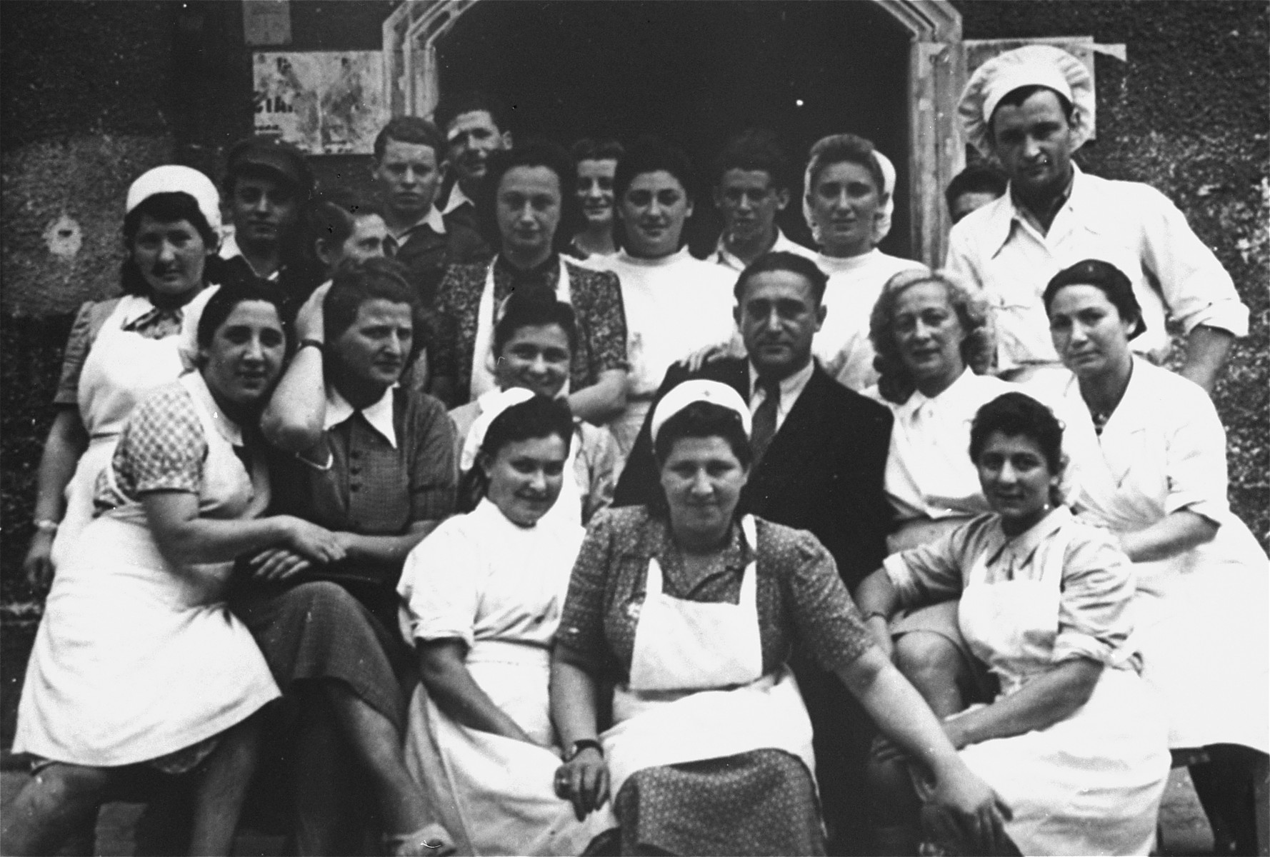 The nursing staff at the UNRRA house in the Landsberg DP camp.   Second from right in the back row (next to the chef) is Tonia Rotkoff.