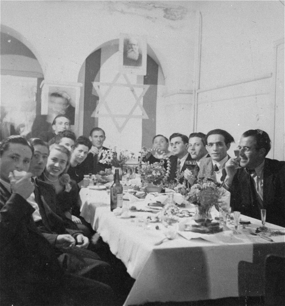 Jewish DPs attend a festive dinner at the Mittenwald displaced persons camp.