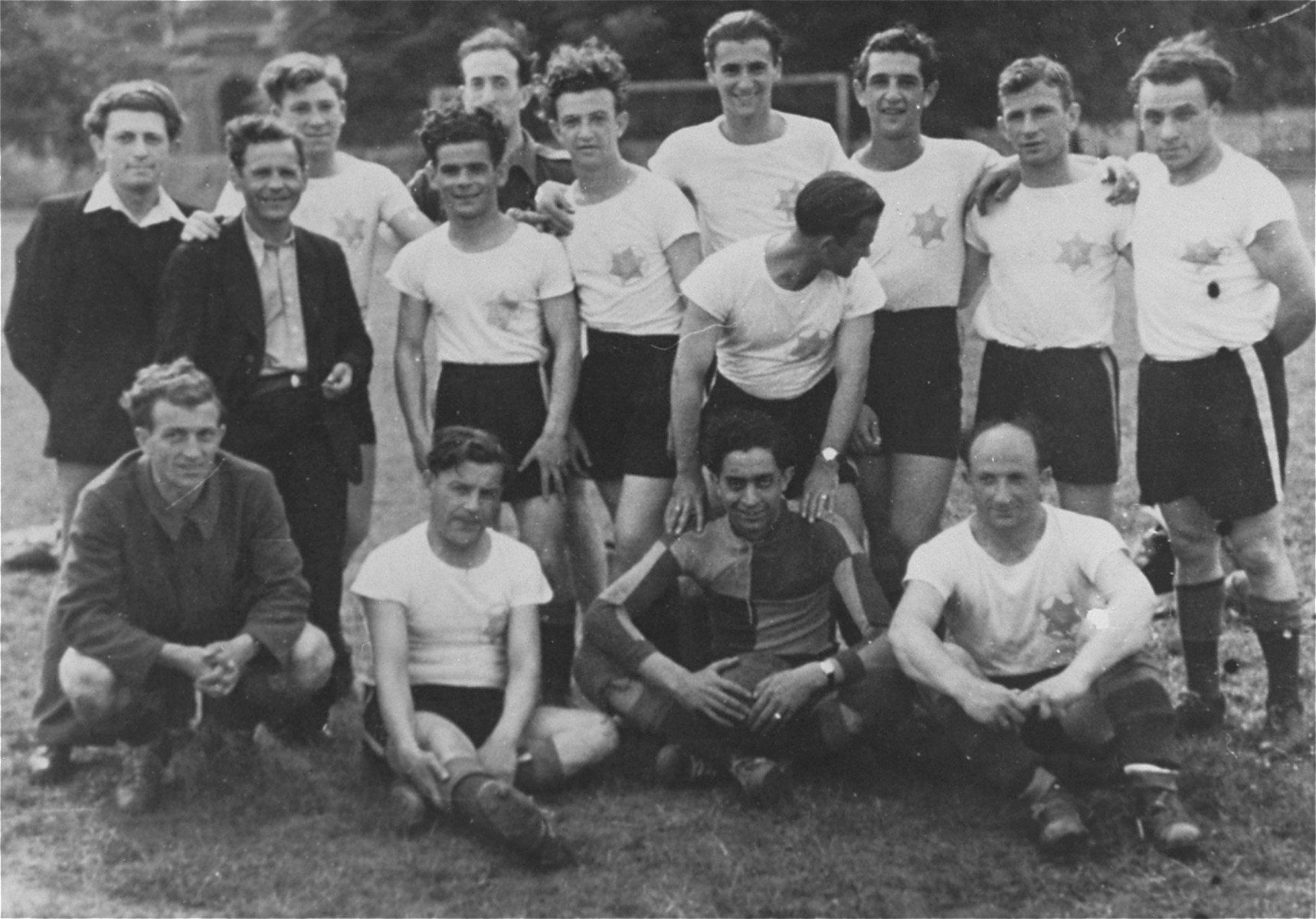 Group portrait of the Jewish soccer team in the Hanover displaced persons' camp.  Among those pictured are Ignaz (Yidel) Rotmench (first row, second from the left), Daniel (Szwajcer) Schweitzer  (standing third from the right), and his brother, Leo Schweitzer (standing fifth from the right).