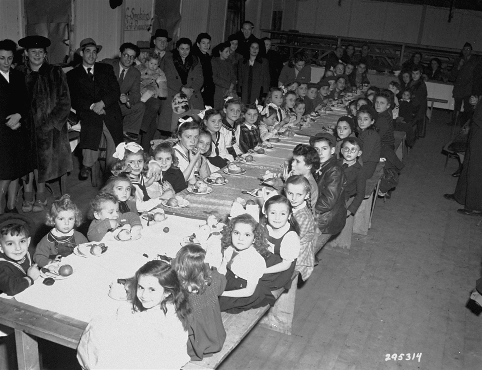 A Hanukkah party for the Jewish children at the Finkelschlag DP camp in Fuerth, Germany. The gifts were donated by families of American servicemen stationed in Nurenberg.