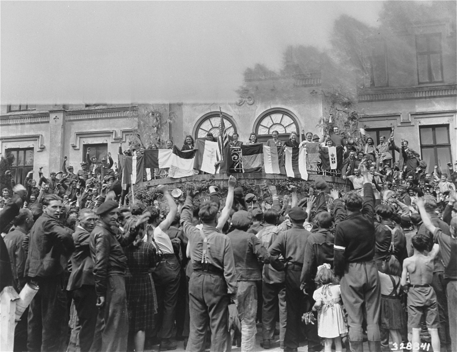 DPs of many nationalities take part in a flag ceremony at the Hagenow displaced persons camp.