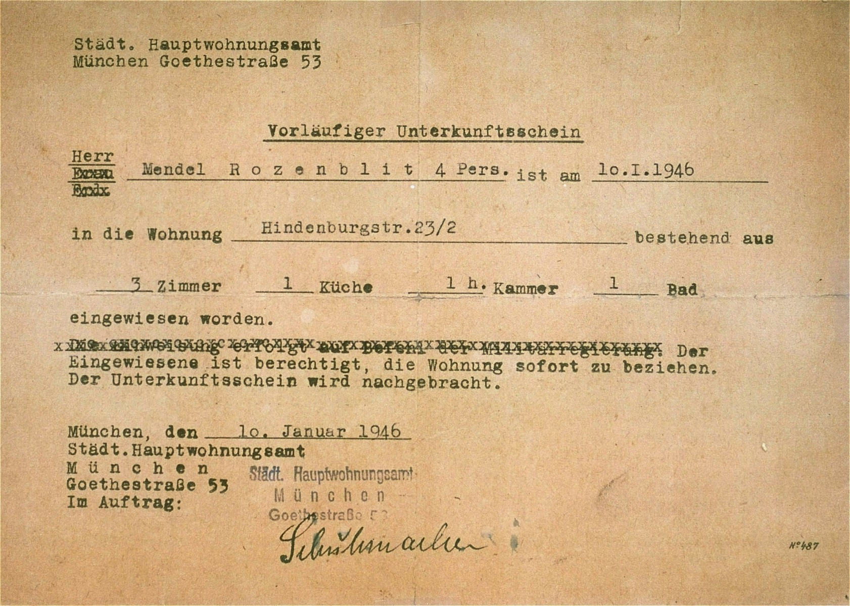 A provisional residence permit issued by the Munich housing office to Mendel Rozenblit, a Jewish displaced person, living in a three-room apartment on Hindenburgstrasse.