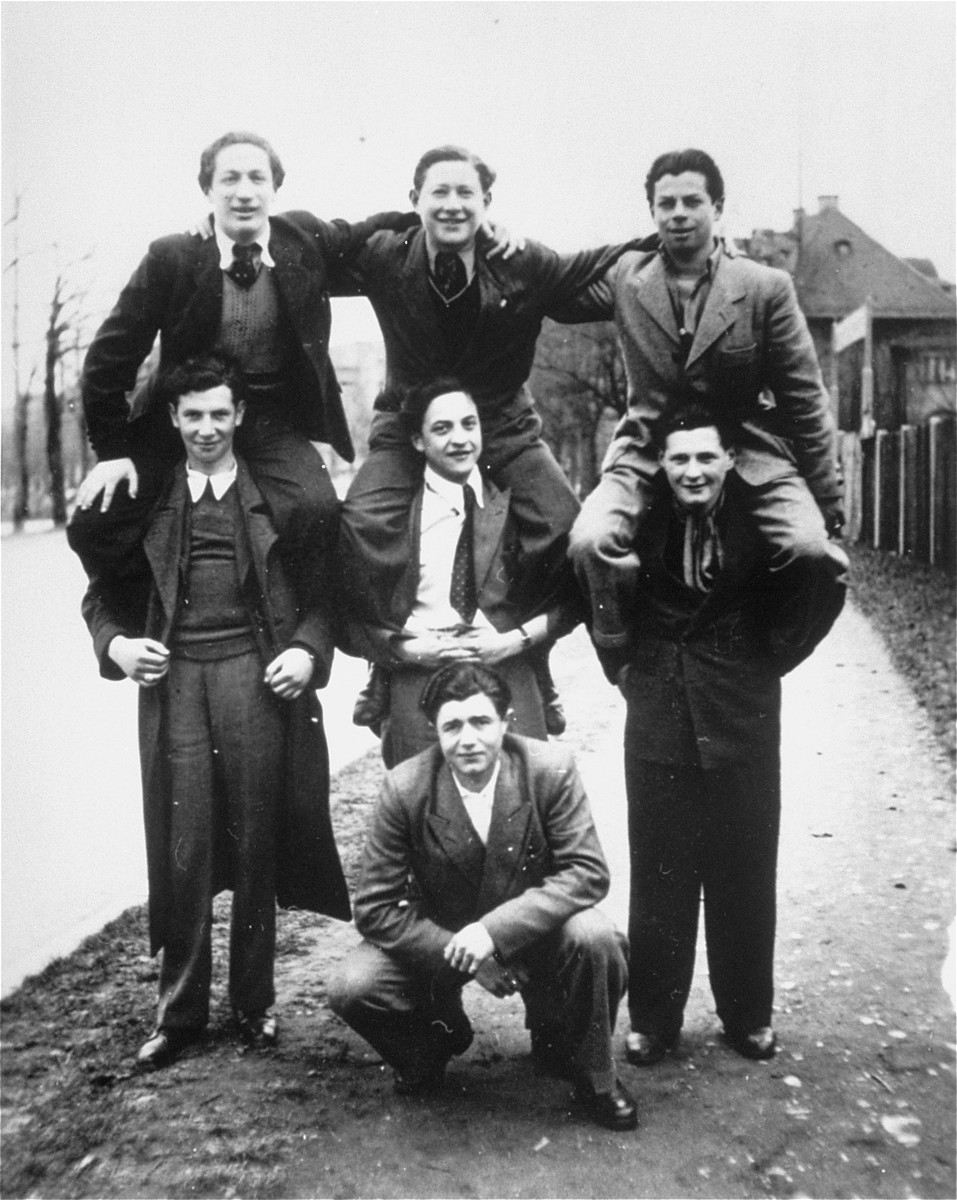 A group of Jewish DPs pose on one another's shoulders in the Landberg displaced persons camp.    Among those pictured are Solly Ganor (center), David Granot (on Solly's shoulders) and David Levine (top, left).