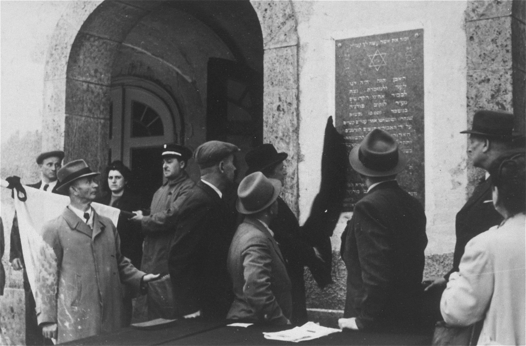 Survivors from Lukow, Poland dedicate a memorial tablet for holocaust victims from their town at a ceremony in Munich.