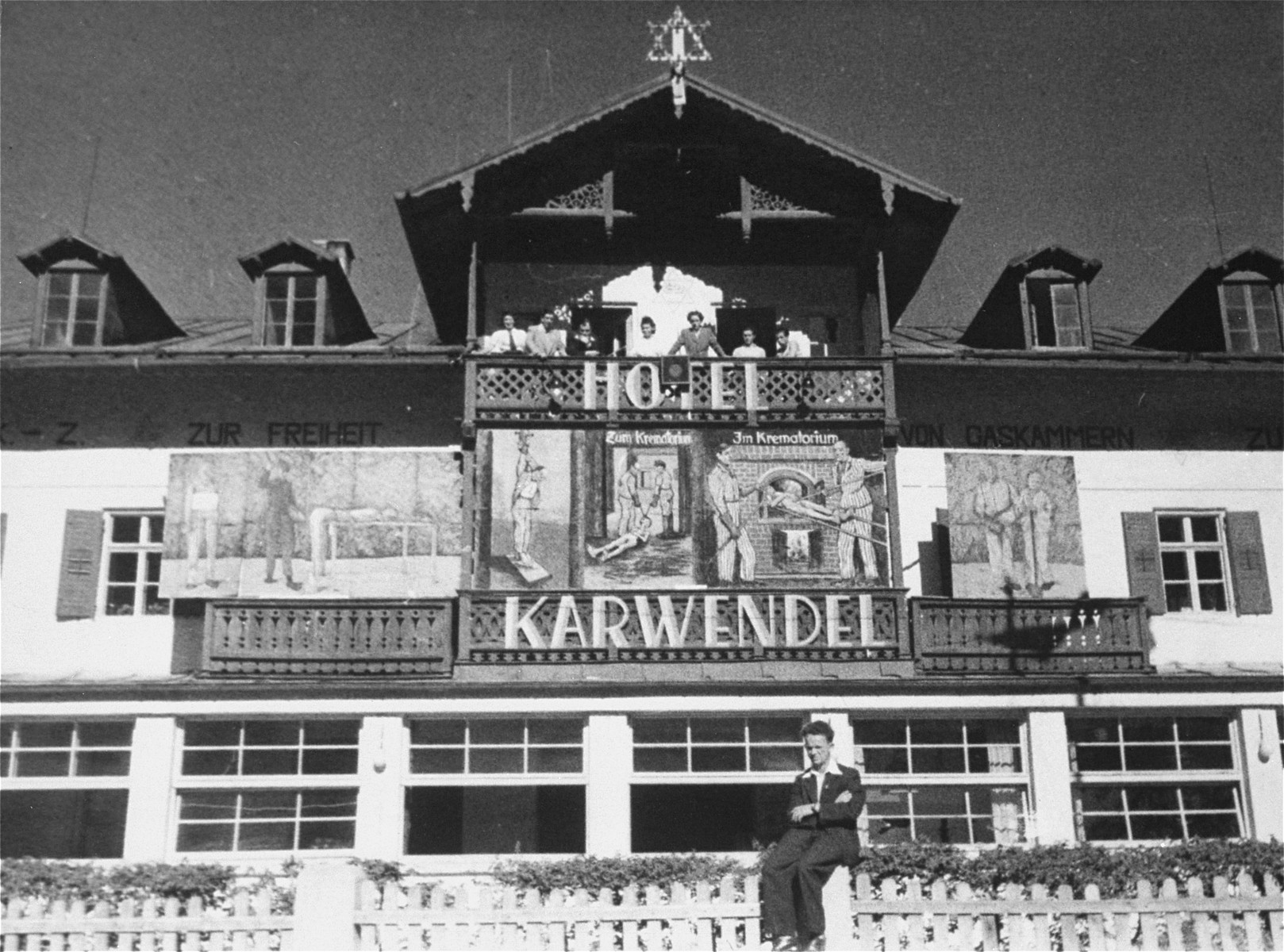 View of the Hotel Karwendel at the Mittenwald displaced persons camp.    The murals on the upper story of the building depict the experiences of many DPs during the war.