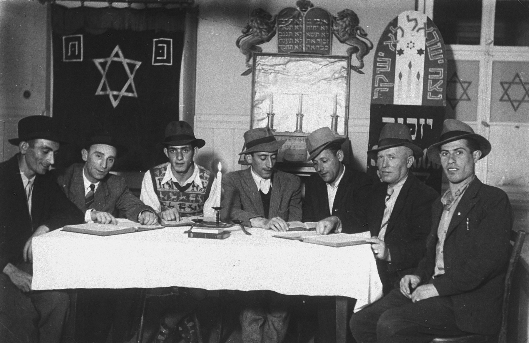 Jewish DPs study religious texts in a synagogue in the Mittenwald displaced persons camp.