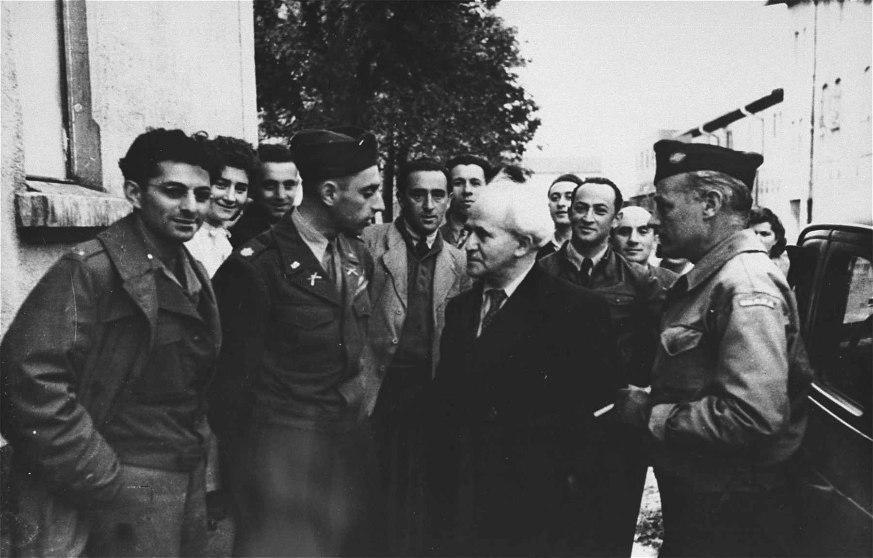 Major Irving Heymont converses with David Ben-Gurion during his visit to the Landsberg displaced persons camp.    Also pictured is U.S. Army chaplain, Rabbi Abraham Klausner (on the left ) and Abraham Glassgold, UNRRA camp director (at the far right).  [oversized print]