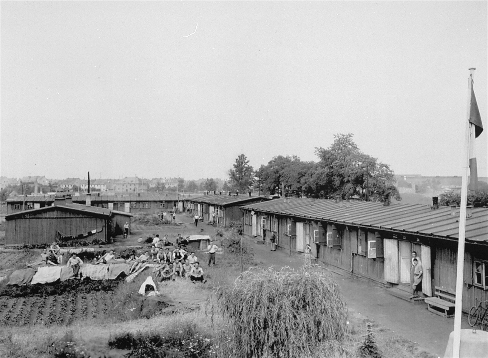 View of the Frohe Zukumft [Happy Future] DP camp.  This is one of 26 DP camps near Halle administered by UNRRA team no.105.  The UNRRA team is responsible for the organization of medical and welfare services and the distribution of food and clothing from requisitioned German stocks.