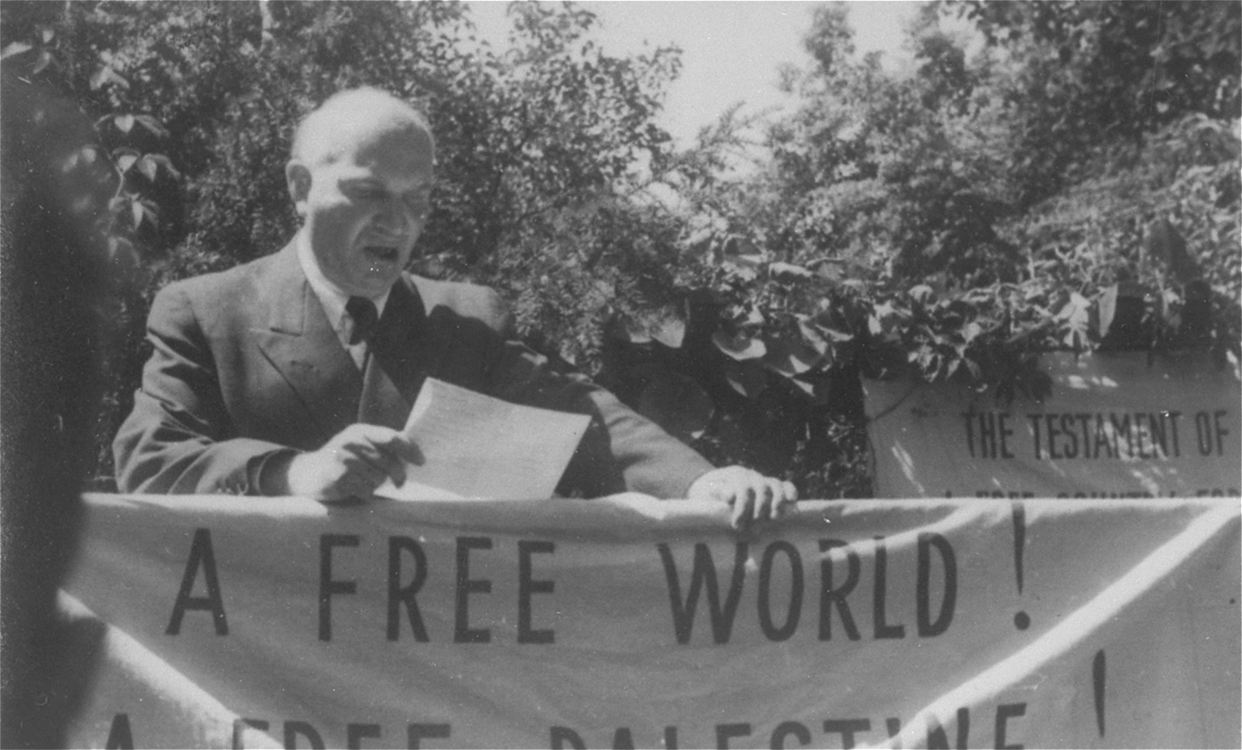David Treger delivers an address at a demonstration in the Foehrenwald displaced persons camp to protest against the capture and return of the Exodus 1947 immigration ship.