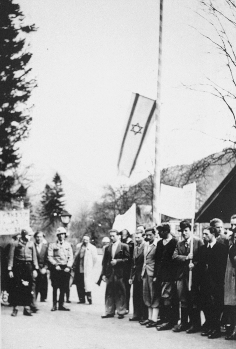 Jewish DPs commemorate the death march from Dachau to Tyrol while they hold a protest against British immigration policy to Palestine at the Mittenwald displaced persons camp.