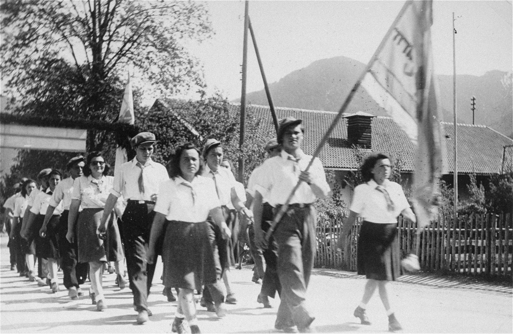 Jewish DPs reenact the death march from Dachau to Tyrol as they march in protest against British immigration policy to Palestine at the Mittenwald displaced persons camp.