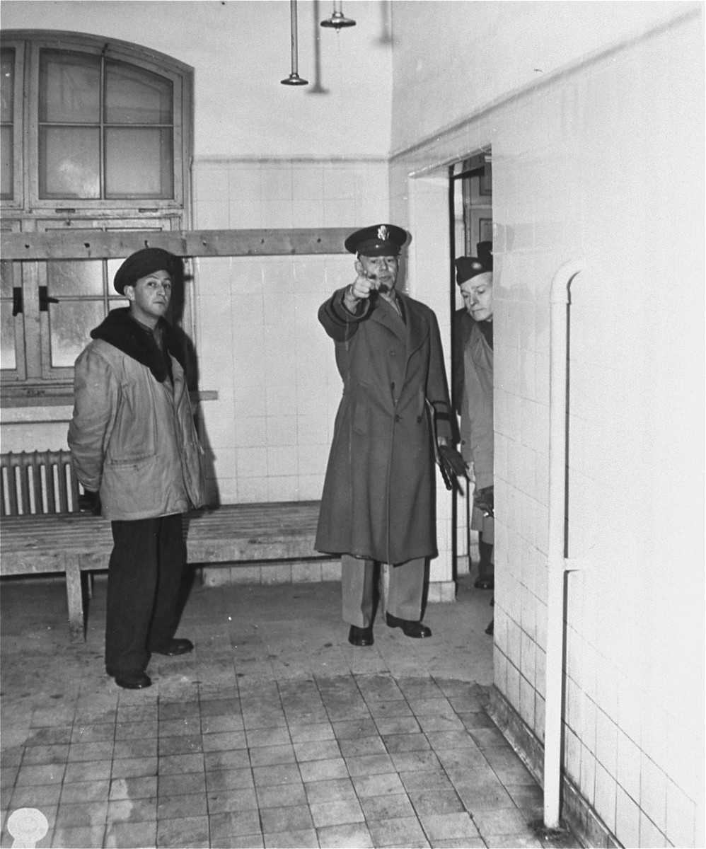 Lt. Gen. W. Bedell Smith, center, chief of staff, US Forces European Theatre, on an inspection tour of living conditions at Jewish centers in Germany, examines lavoratories at Landsberg DP camp.