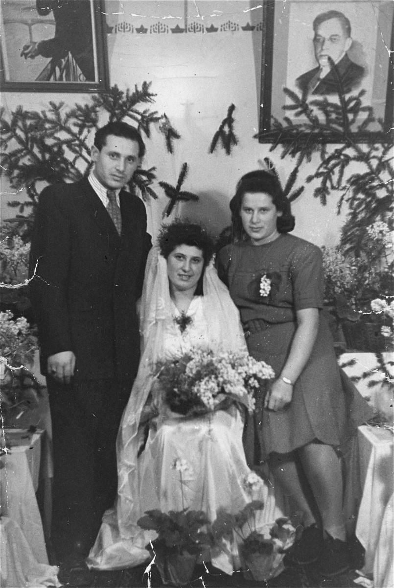 Wedding portrait of the donor's sister Maszda Rozenroth in a DP camp in Munich.  The donor is pictured on the left and his sister Gucia Zawodnik, on the right.