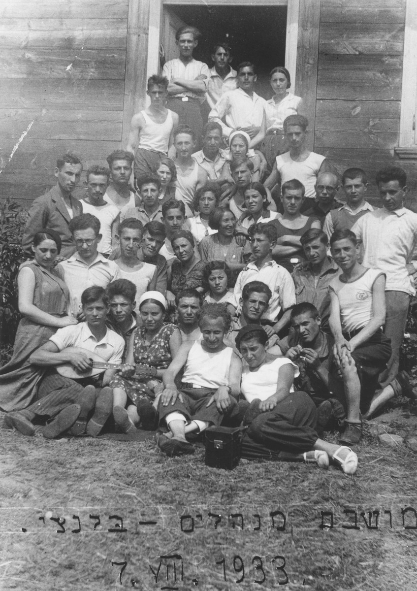 Group portrait of the members of a Zionist hachshara [agricultural collective] from Belynichi in front of a cabin.