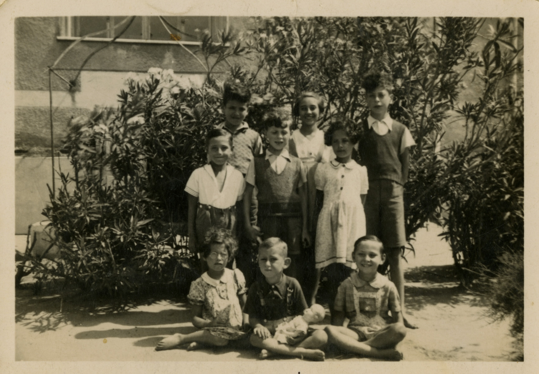Group portrait of Jewish and Spanish children  in the Villla Saint Christophe in Canet-Plage.  Berthe and Claire Landesmann are seated on the far left and standing in the second row on the right.  Jacques Landesmann is standing in the third row on the left.  Ginette Druker is standing third row, center and Jacques Klotein is third row, far right.