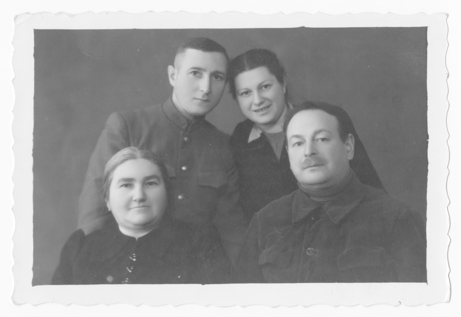Postwar portrait of the Tenin family.  Pictuured are Moshe and Golda Tenin with their two surviving children, Boris and Klara.
