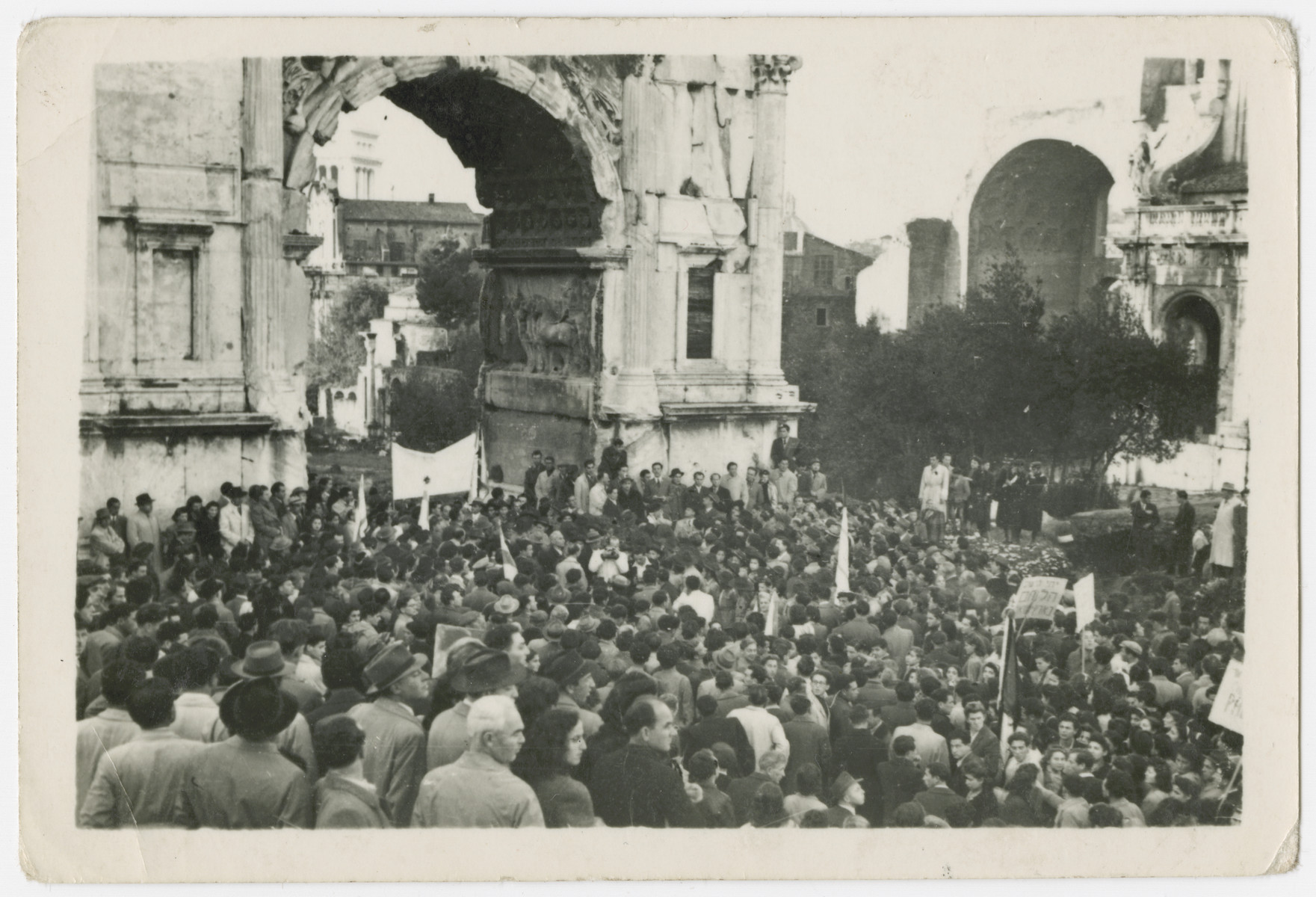 Jewish displaced persons celebrate the UN Partition of Palestine by gathering by the Arch of Titus in Rome.