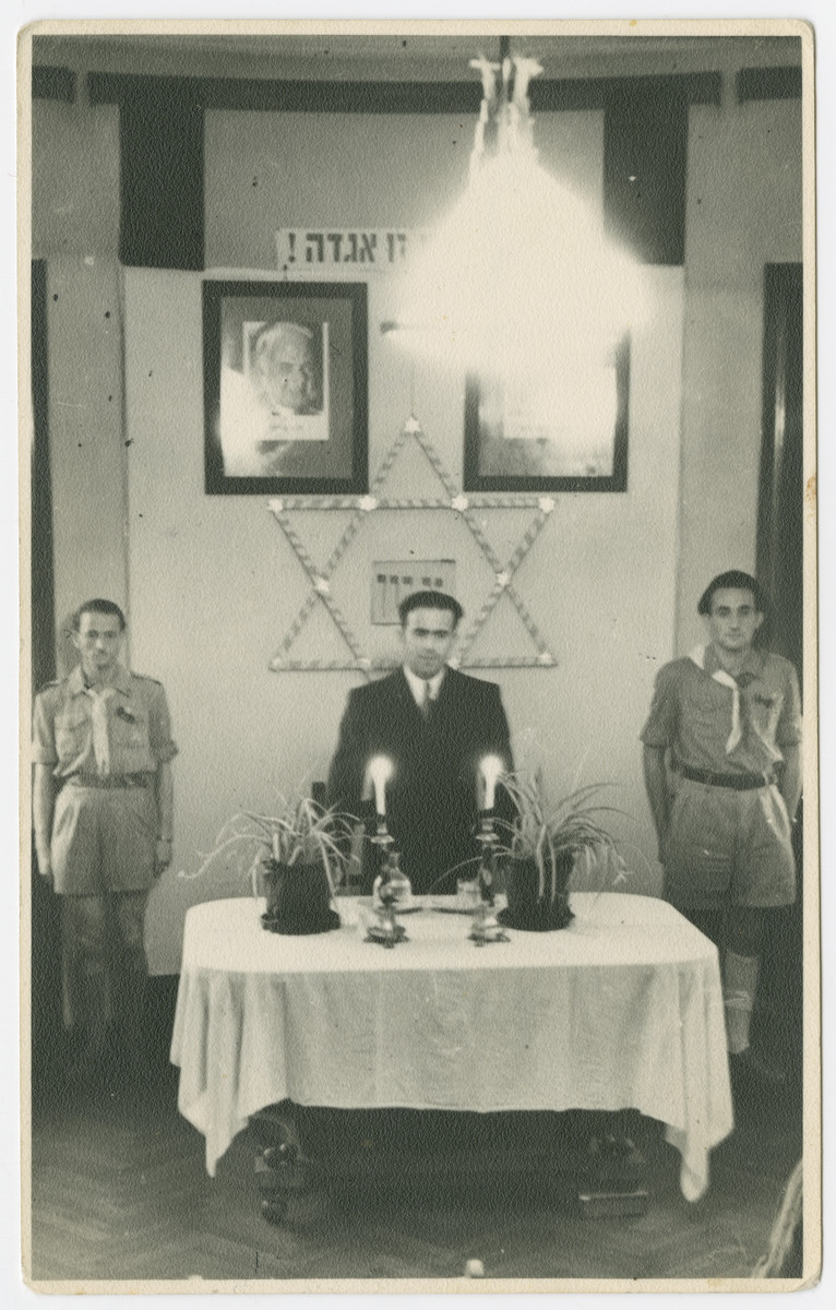 "Jewish displaced persons conduct a memorial service to Theodore Herzl and Chaim Nachman Bialik in a convalescent home in Rome.  The original caption reads: ""To Zelig Appel: As a memory from Henryk Turk.  This picture is taken during a tribute to Dr. T. Herzl and Chaim Nachman Bialik in an AJDC convalescent home in Rome."""
