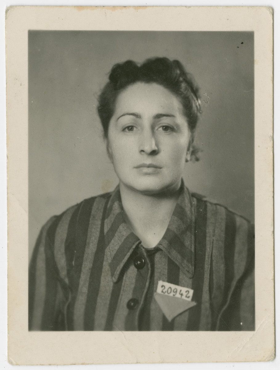 Ella Wieder Freilich poses in her concentration camp uniform after liberation.