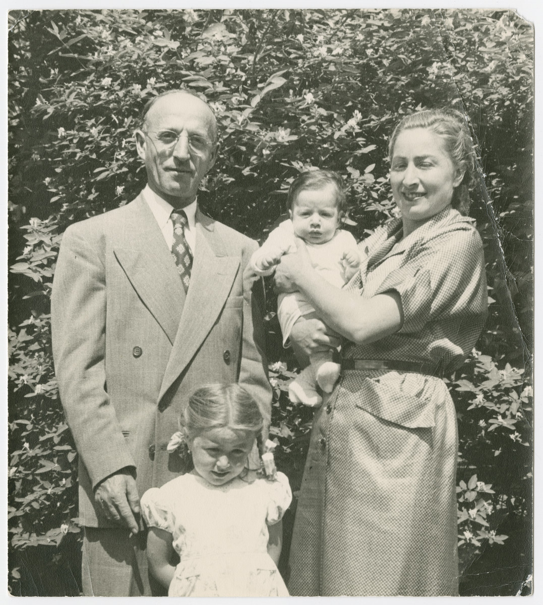 Rabbi and Mrs. Freilich pose with their two young children, Hadassah and Ary, in Gardener, MA.