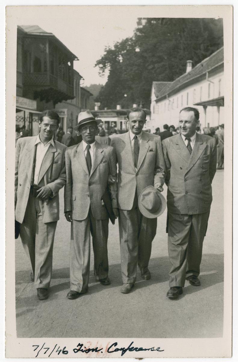 Four delegates to the 22nd Zionist Congress walk down a street in Basel.  Rabbi Samuel Freilich is pictured second from the left.
