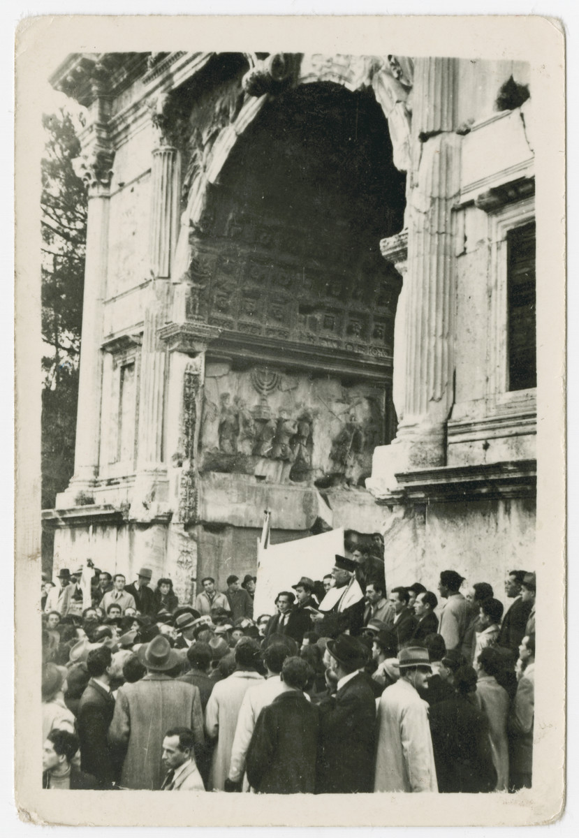 Jewish displaced persons celebrate the UN Partision of Palestine by gathering by the Arch of Titus in Rome.