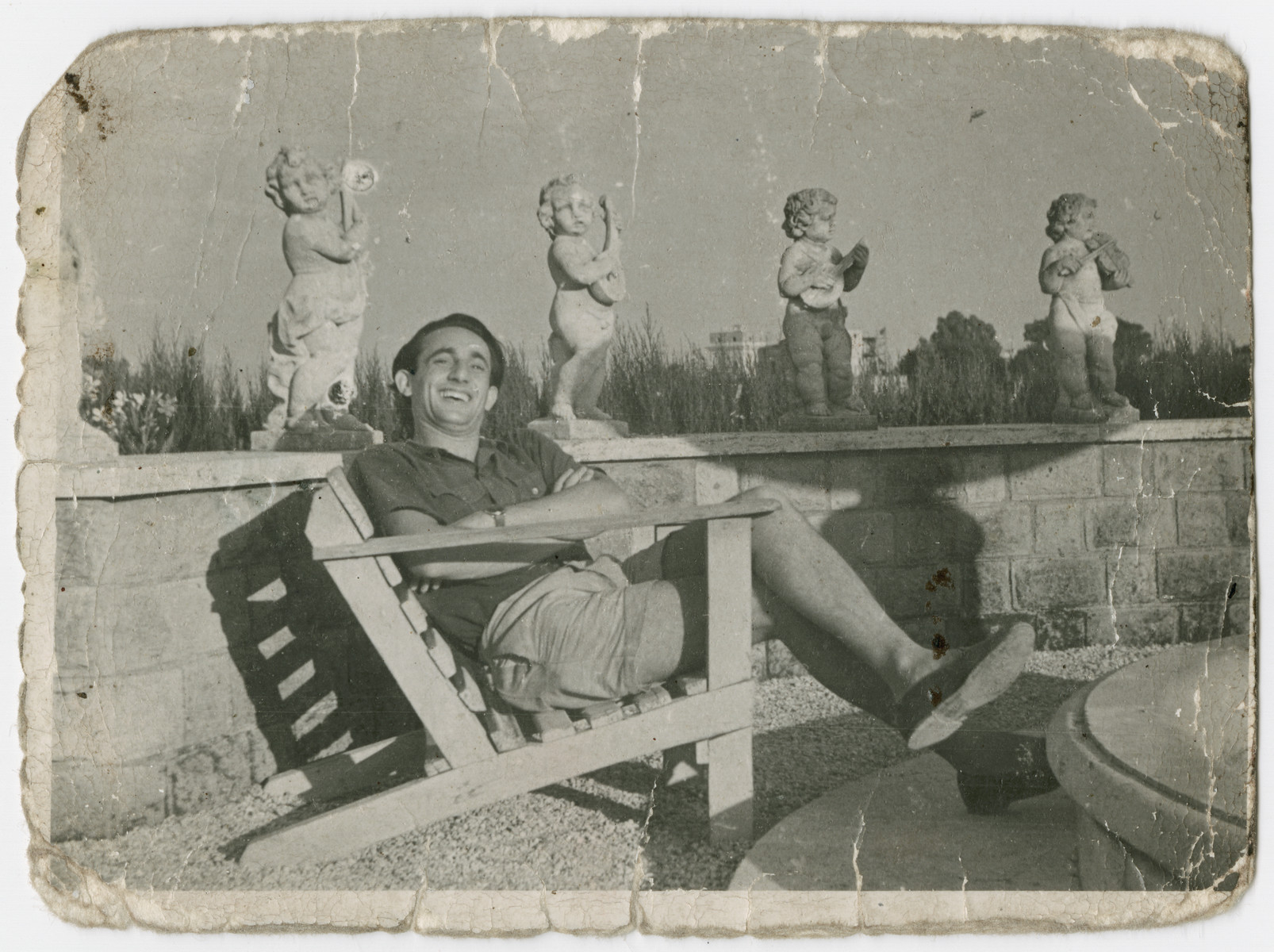 Zelig Appel relaxes on a patio in Italy.