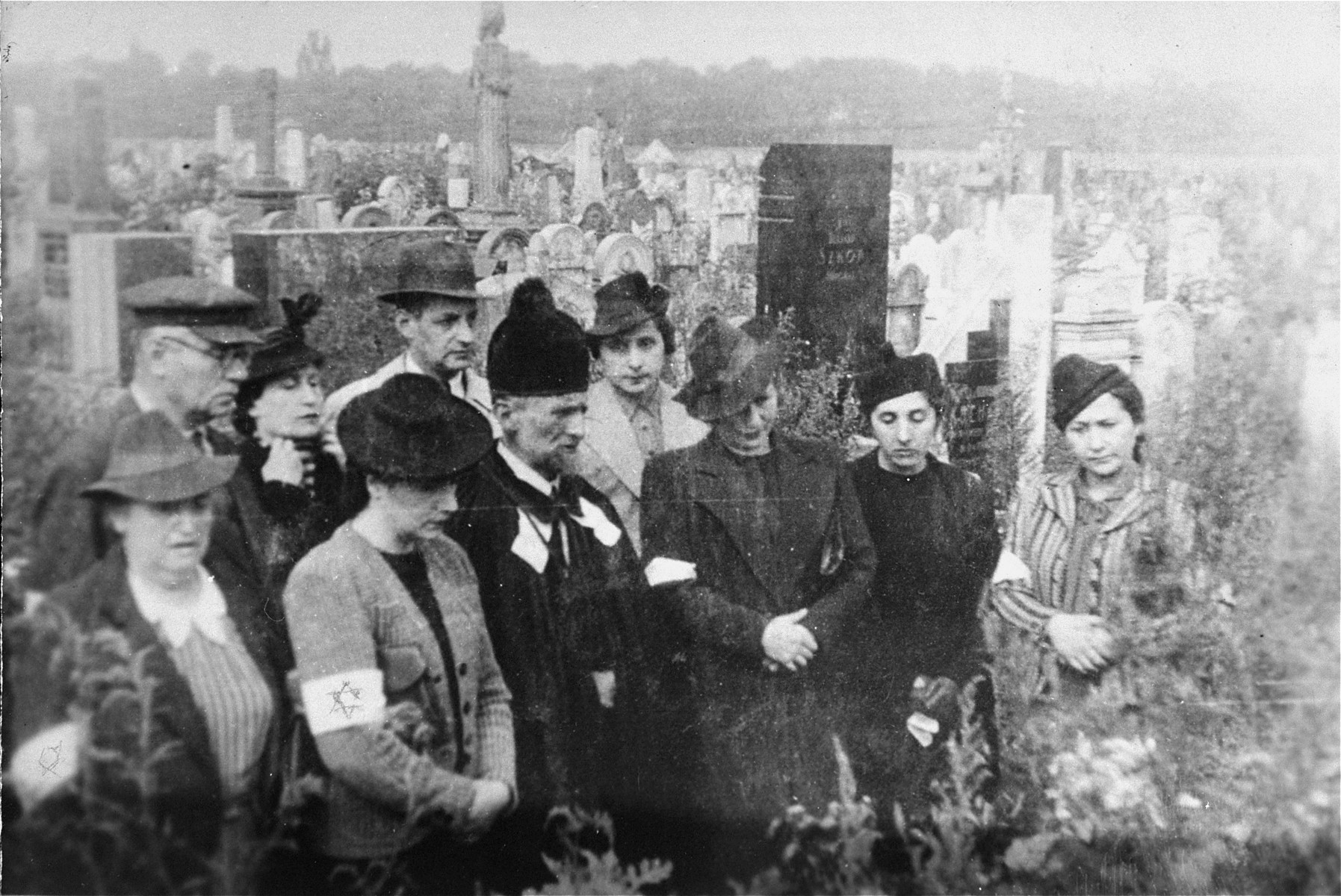 Ghetto residents attend a memorial service for a relative at the Jewish cemetery in Warsaw.  Pictured are Hela, Hanka, Fela and Edzia Berkowicz.